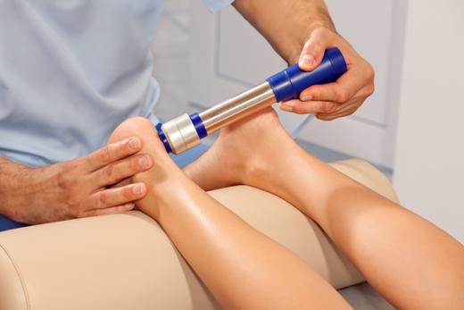 orthopedist-making-Shock-wave-therapy